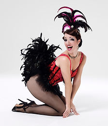 Amy G by Perou kneeling showgirl in pink and black