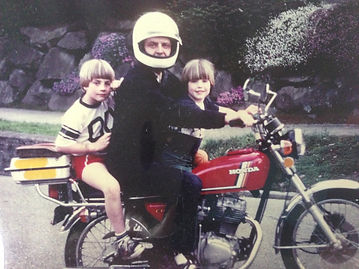 Amy G family on a Honda motorbike 2 kids and dad bowl cuts