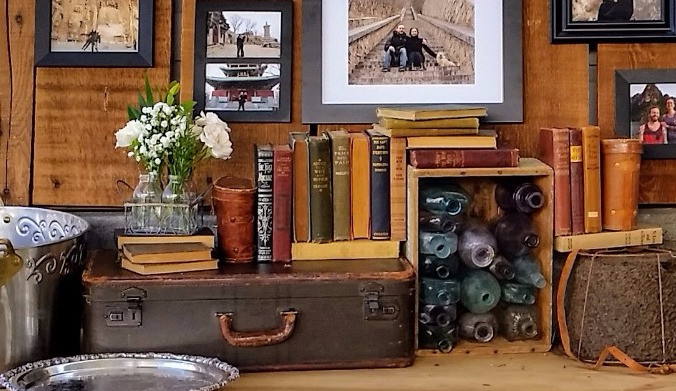 vintage rental pieces, old books, bottles & suitcases