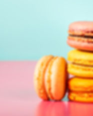 Stack Of Macarons On Pastel Background.j