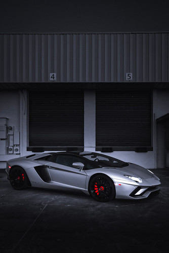 Aventador S Roadster near warehouse