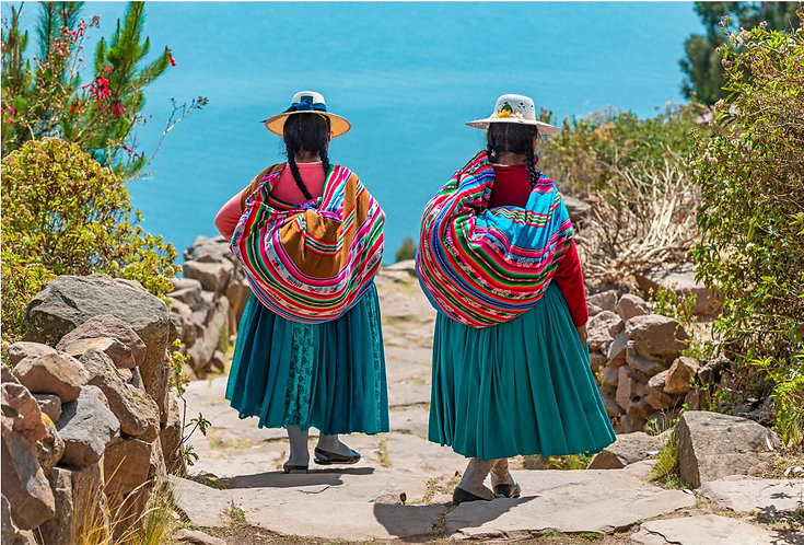 Ecuador Two Ecuadorian women walking in traditional attire.JPG