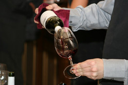 waiter-pouring-wine-from-bottle-into-wineglass