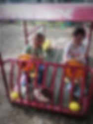 2 kids on fire truck.jpg