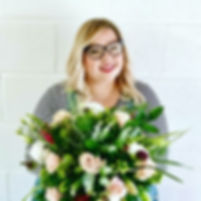 Creative director Beth holding a big beautiful bouquet of flowers