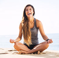 Girl laughing while doing yoga
