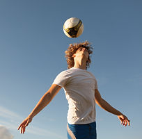 Man heading soccer ball
