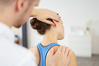 Physical therapist stretching woman's neck