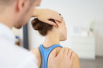 Physical Therapist stretching girl's neck
