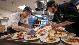 Chefs finish decorating delicious tapas plates for a large event at The Boathouse in Richmond, Virginia