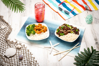 A tropical beach themed food spread of refreshing and colorful protein bowls.