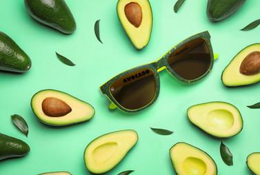 An avocado themed product shoot for Knockaround sunglasses