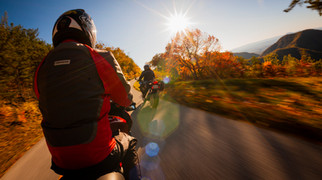 Travel and tourism ad in Virginia using specialized camera rigs: motorcycles ride towards a fall sunset in the mountains.