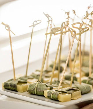 Delectable cheese cube hors d'oeuvres wrapped in grape leaves