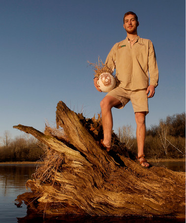 An outdoor feature portrait for Sports Illustrated of Adam Ales, dressed up like Tom Hanks in Castaway.