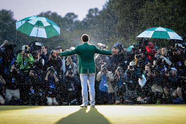 A dramatic sports portrait of Adam Scott celebrating in the rain after winning the 2013 Masters golf tournament in Augusta, Georgia.