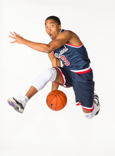 A dynamic action sports portrait of a University of Richmond basketball player created in studio.