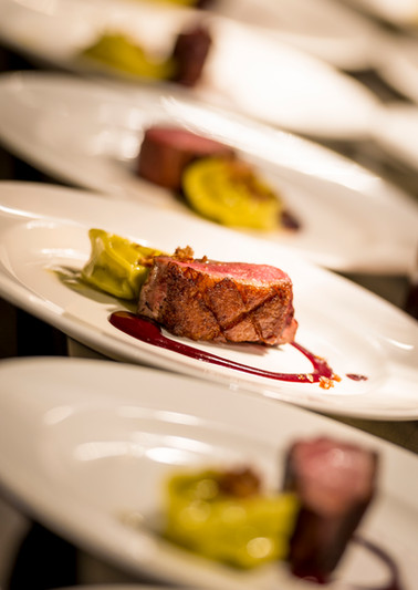 Food photography of a tender grilled steak medallion as part of a five course dinner