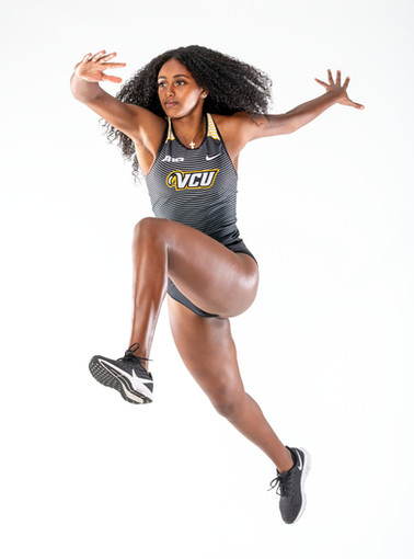 A creative action sports portrait of a Virginia Commonwealth University track athlete created in the studio.