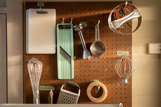 An assortment of baking tools hang in the late afternoon light in the back of the kitchen at Sub Rosa bakery in Richmond, Virginia