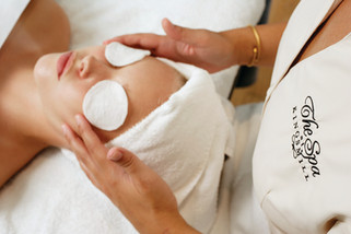 A feature advertisement of a woman peacefully relaxing during a spa treatment in Virginia.