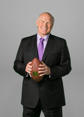 Terry Bradshaw poses for a portrait while holding a football.