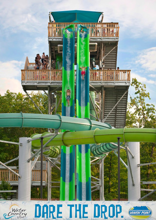 Patrons plunge down the massive and colorful drop slide, Vanish Point, at Water Country USA in Williamsburg, Virginia.