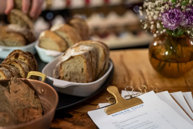 An tasty spread of bread appetizers on display at The Broken Tulip restaurant, a communal farmhouse style eatery