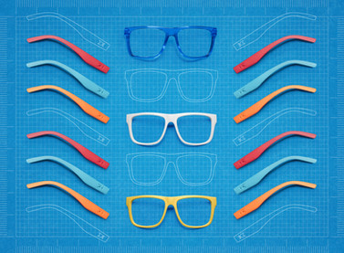 A creative advertising shot of Knockaround sunglasses laid out like a blueprint