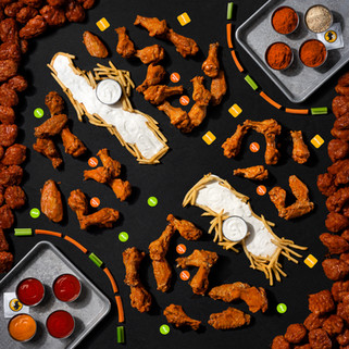 An overhead view of a large spread of Buffalo Wild Wings food in the shape of a League of Legends map.
