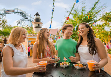A family enjoys a summer day with tropical drinks and international food at a culinary event at Busch Gardens Williamsburg in Virginia.