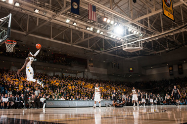 Briante Weber finishes a thunderous slam dunk in a college basketball game featuring VCU vs. Butler in Richmond, Virginia.