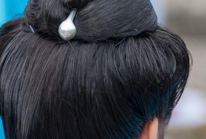 伝統の髪結い(カラジ結い)と銀製のかんざし(ジーファー)・「琉球王朝祭り首里『古式行列』」