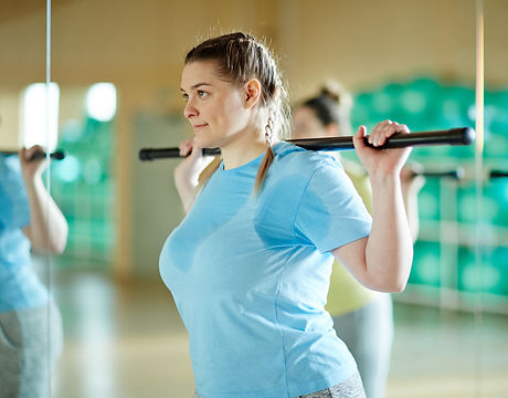 Young sweaty oversized woman with gymnas