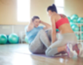 Fitness instructor helping young oversiz