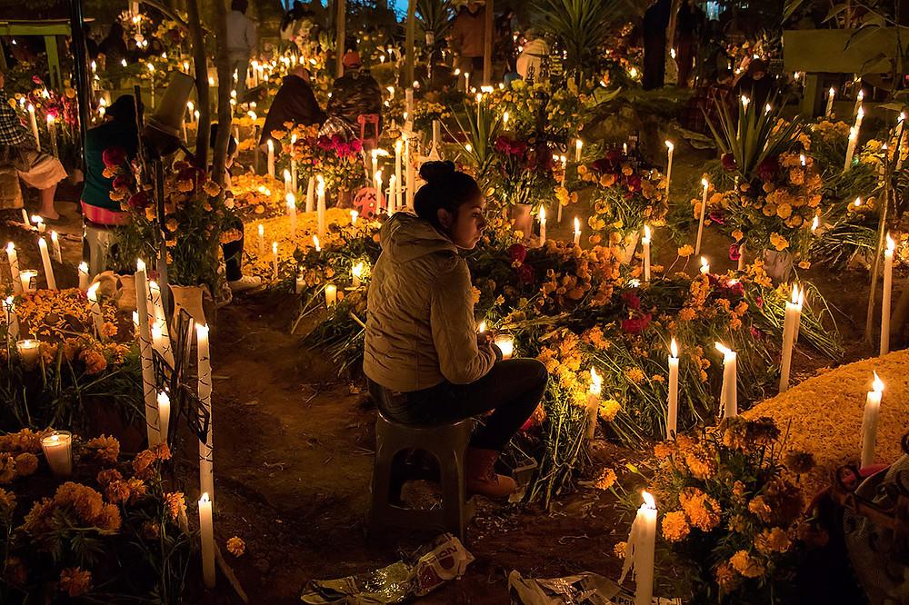 A decorated cemetery for Dia de Los Muertos.