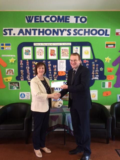 Donal O'Hallaran of IFAC Accountants Balla presenting cheque to Principal Fiona Byrnes