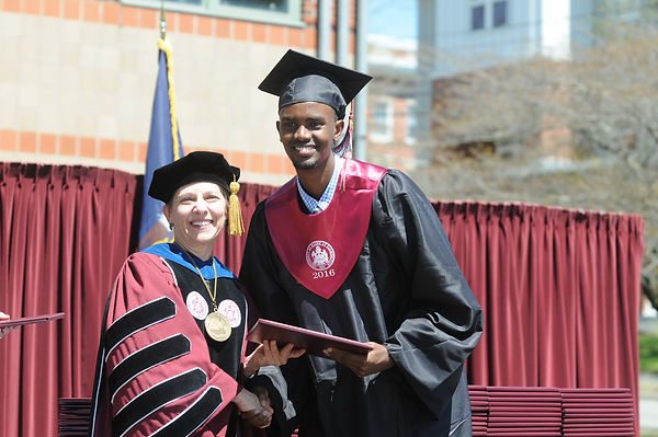 UMF student graduating and walking across the stage.