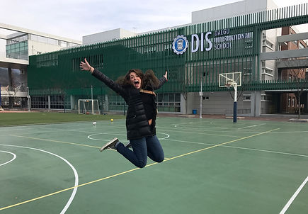 Tori Lands '17 (Secondary Ed Social Studies) jumping for joy at her arrival at Daegu International School in South Korea! She was hired after student teaching at DIS!