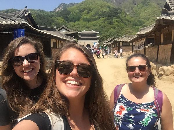 Students taking a selfie in a village