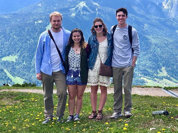 Students posing for a photo on front of mountains