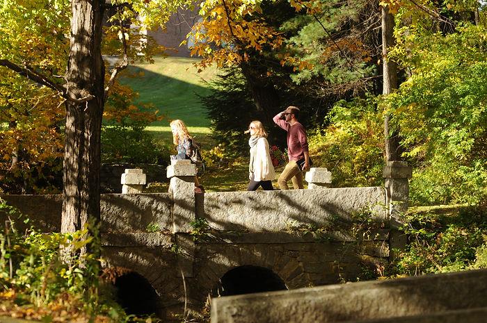 Students walking across a bridge