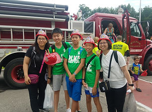 Exchange students and faculty members in front of a fire truck.