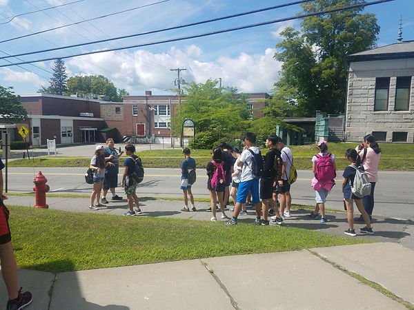 Student workers, Kelly Toomey and Brock Bubar, lead the 2018 Hong Kong Student Exchange students on a tour around the UMF campus and downtown Farmington.
