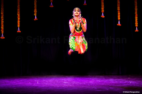 A moment caught in a Bharatanatyam performance