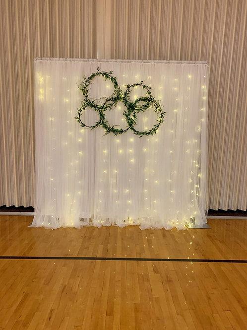 White Fairy Light Backdrop w/Greenery Hoops/ Netting