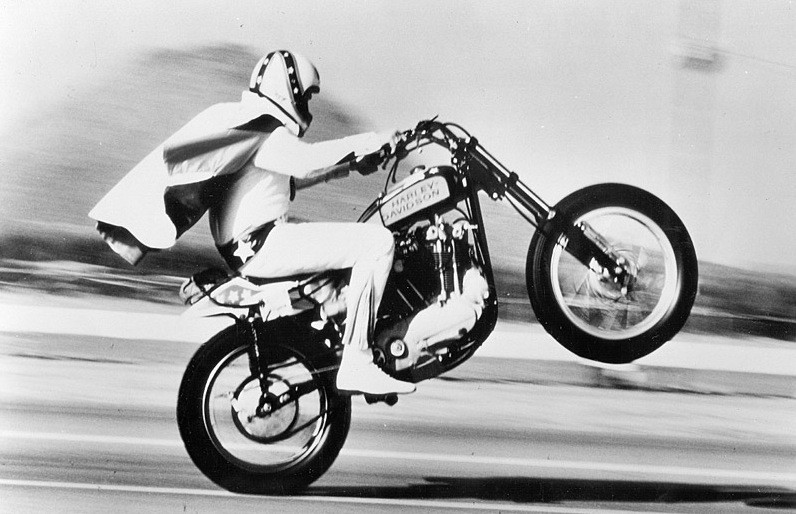 Evel Knievel pulls a monster wheelie on his Harley