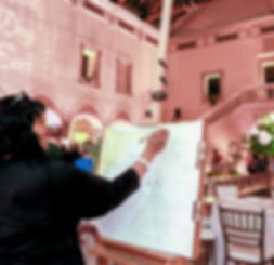 Executive Director and Event Designer, Janel Bailey Keen of Vivd Expressions sketching and painting a wedding event live at Chrysler Museum of Art, Norfolk, Virginia