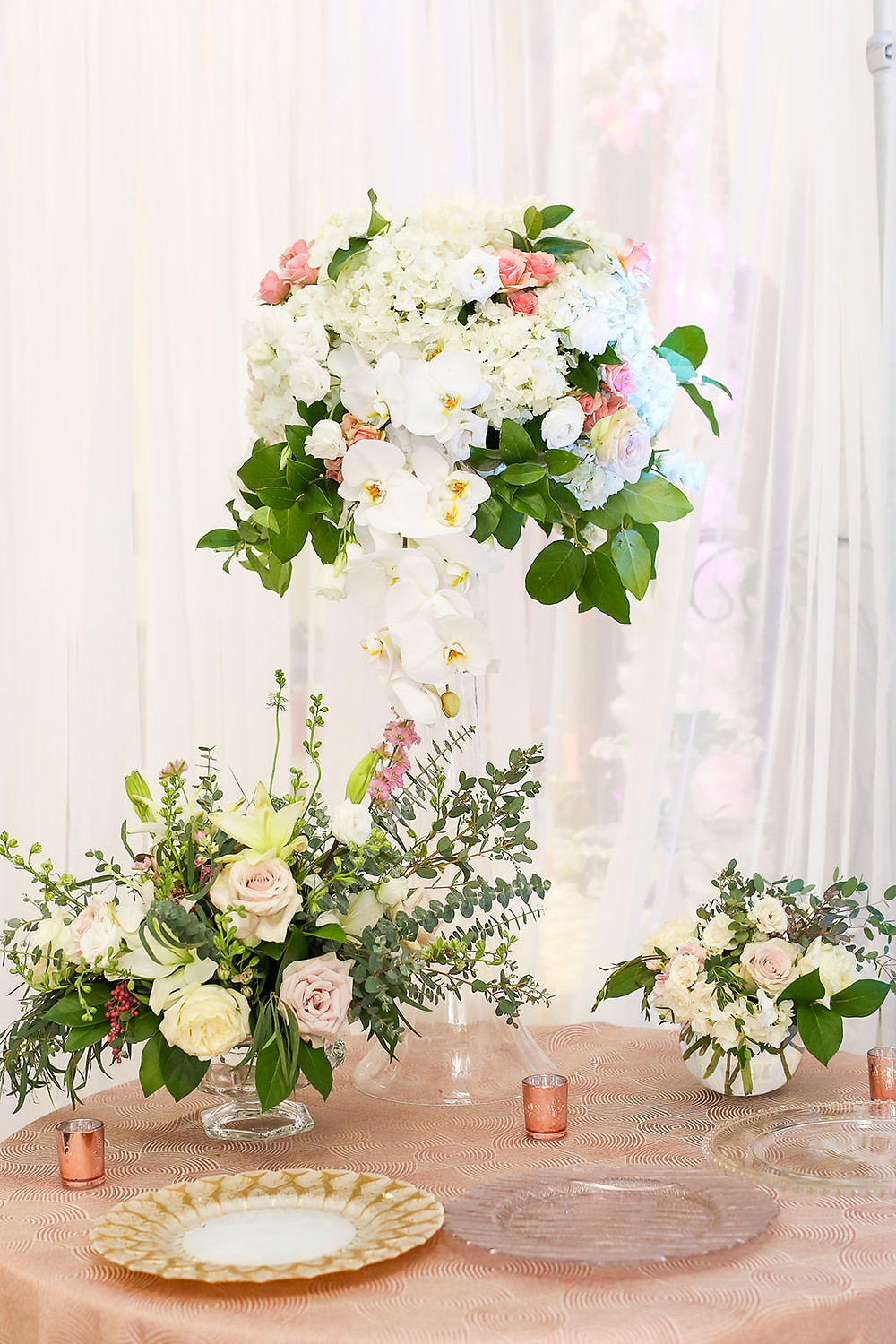 Vivid Expressions Centerpieces roses orchids pink white