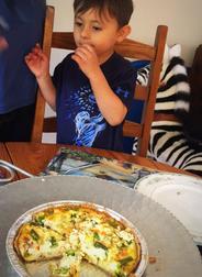 Child eating quiche